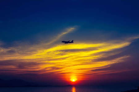 sunset  at the beach with airplane  at Koh Samui,Thailand Stock Photo