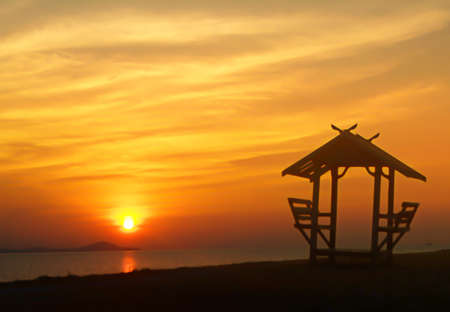 beuatiful sunset  at the sea  with a little hut on the beach ,Thailand   abstract  summer nature wallpaper  background