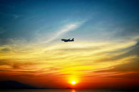 beuatiful of colorful  sunset  background with airplane