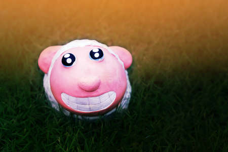 cute sheep doll  smile  in green  grass field