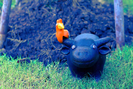 cute buffalo and bird  clay doll decorate in the garden Zdjęcie Seryjne