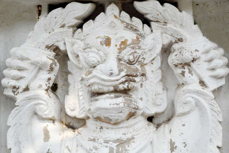 Thao Wes Suwan low relief statue on wall Banque d'images - 124728870