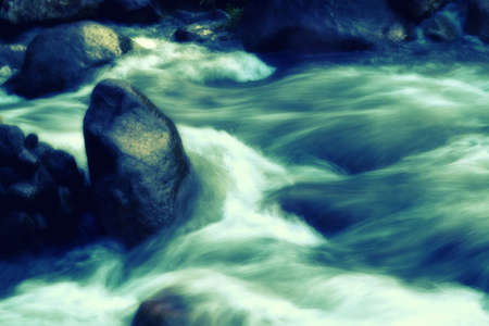 water stream and rock  fresh,calm  nature background with filter effect