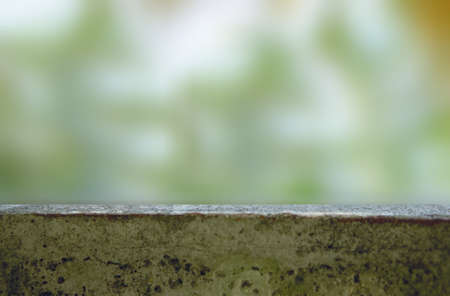 old concrete  table with blur green bokeh abstract display background