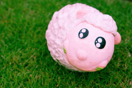 cute sheep clay doll  eating green grass in fields