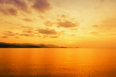 Sunset at sea with  gold sky  and island landscape background,Koh Samui ,Thailand
