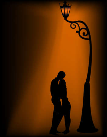 Silhouettes of two lovers under a lantern photo