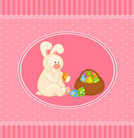 Easter Bunny with colored egg. Easter card photo