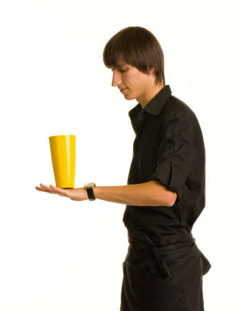 Young bartender does a trick with a shaker and bottle on white background photo