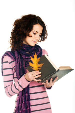 Beautiful  girl with book on white background Stock Photo - 11656046