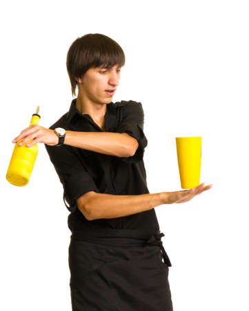 bartender does a trick with a shaker and bottle  photo