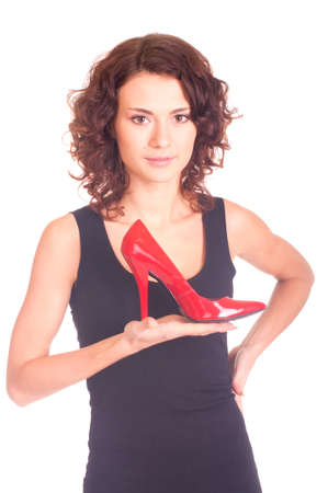 Beautiful smiling girl with red shoe on white background Stock Photo - 11656010