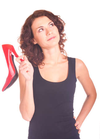 Beautiful smiling girl with red shoe on white background Stock Photo - 11656009