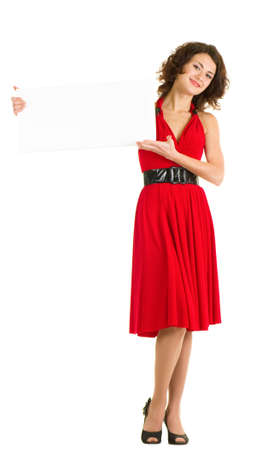 Sexy young woman in red dress isolated photo