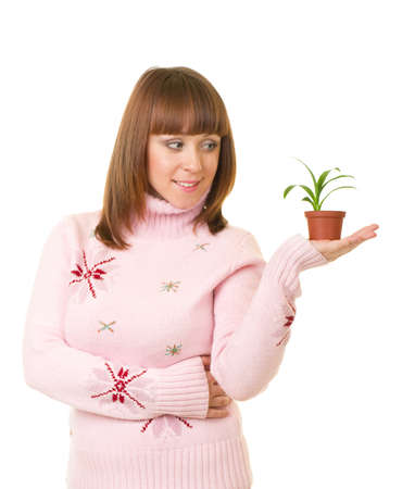 Beautiful smiling girl holding a small plant on white background Stock Photo - 11778543