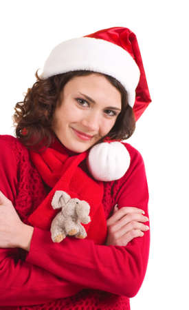 Beautiful young girl in Santa Claus clothes photo