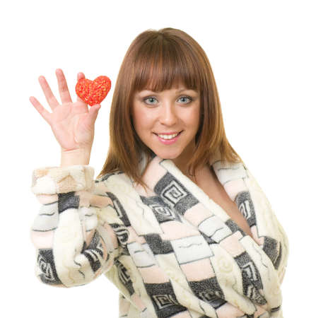 red bathrobe: Young woman in a plush bathrobe with red heart against