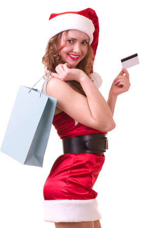 woman in Santa Claus clothes with credit card  Stock Photo - 11778451