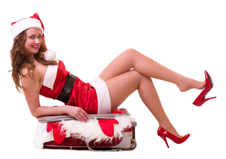 Beautiful young woman in Santa Claus clothes dreaming about vacation  Stock Photo - 11778456