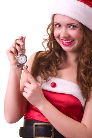 Beautiful young woman in Santa Claus clothes with Clock on white background. photo