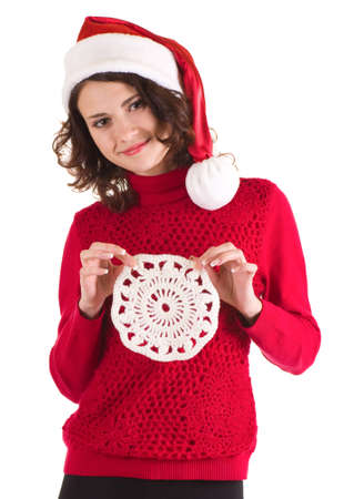 Beautiful young girl in Santa Claus clothes on white background photo