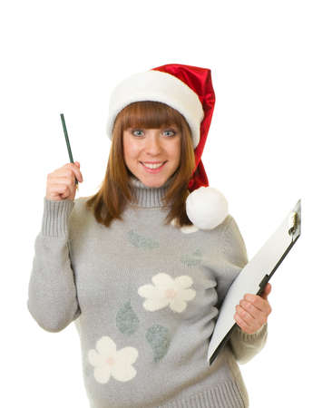 Beautiful young woman in Santa Claus clothes leaning on blank board  photo