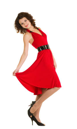 Sexy young woman in red dress isolated on white background.