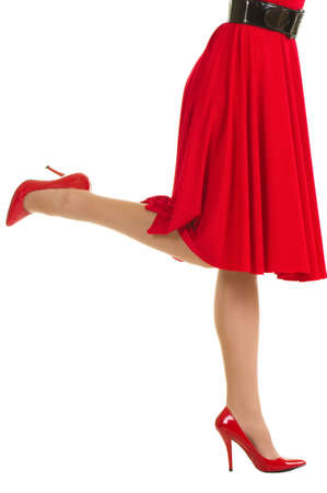 Sexy legs in red high heels and dress isolated Stock Photo - 11778347