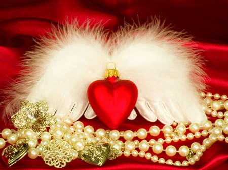 Valentine heart with wings on red background photo