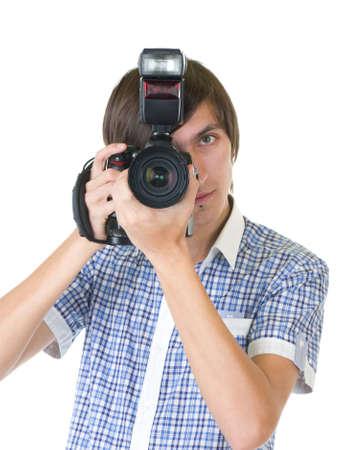 young man photographer doing photos by digital camera photo