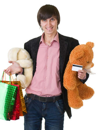 Young man with gifts for valentines day and credit card  photo