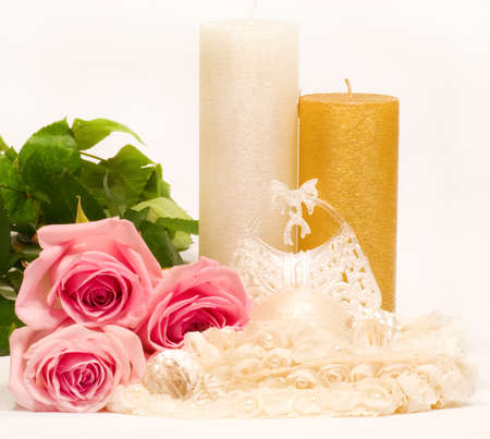 Romantic still-life with candle and pink roses photo