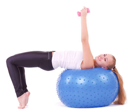 Young woman in gym with a blue ball photo