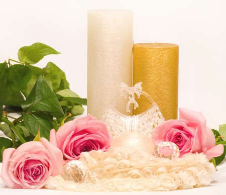 Romantic still-life with white candle and roses photo