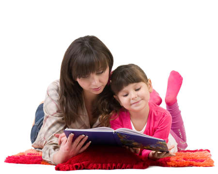 Mother and daughter reading a book on white background.