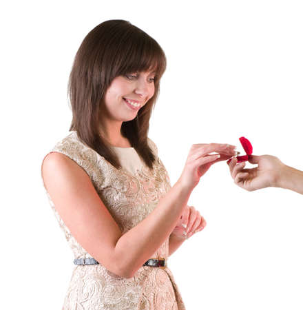 Proposal scene with happy beautiful woman on white background photo