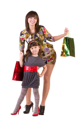 Happy mother and little girl with shopping bags isolated on a white background photo