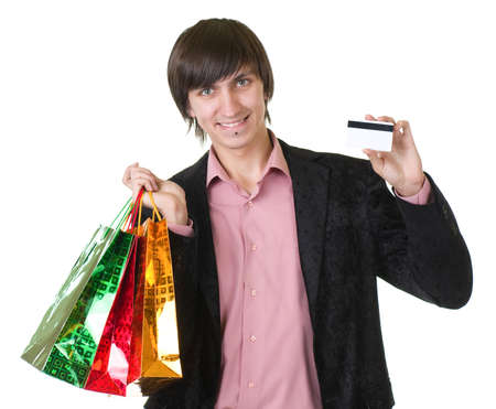 Young man with credit card and shopping bags isolated  photo
