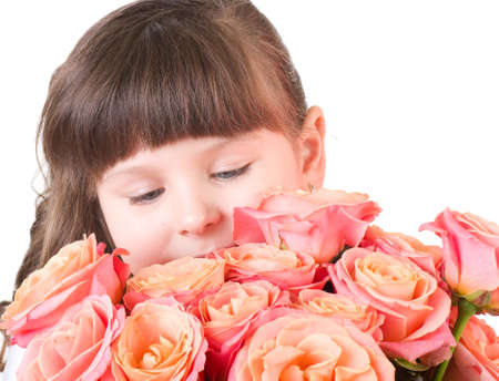 Cute little girl with pink roses on white background photo