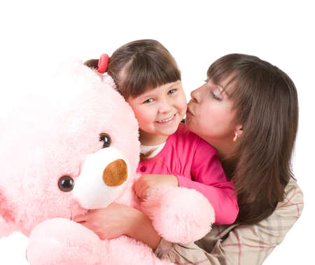 mother and her little daughter embracing with pink bear Stock Photo - 12030775