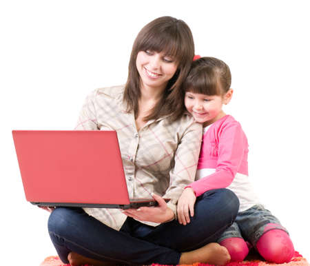 personal computers: Happy family, young beautiful mother and her little daughter with laptop isolated over white Stock Photo