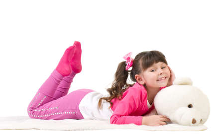 Cute little girl with  bear on white background photo