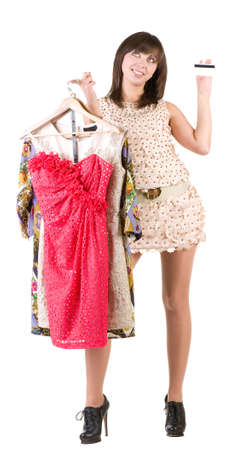 Happy young shopping woman with credit card and new dresses isolated on a white background Stock Photo - 12010267