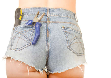Female worker with tools in back pocket on shorts photo