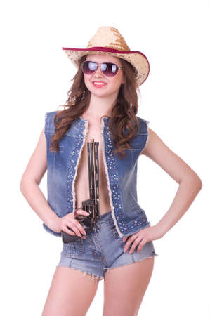 Pretty girl with cowboy hat with revolver photo