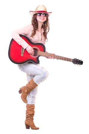 Pretty girl with cowboy hat with guitar on white background