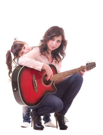 Happy family, young beautiful mother and her little daughter with guitar photo
