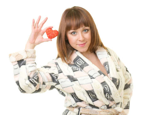 red bathrobe: Young woman in a plush bathrobe with red heart against a white background