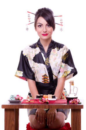Young woman in Japanese kimono with a tray of sushi roll, isolated on white background.
