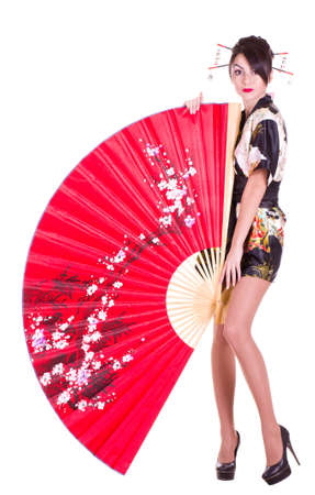 Beautiful young woman in Asian costume with red Asian fan on white background.